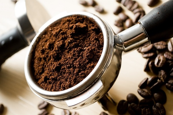 coffee grounds in a special espresso measure