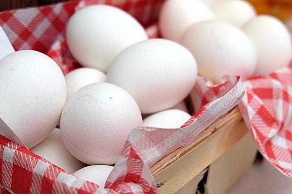 white eggs in plaited basket