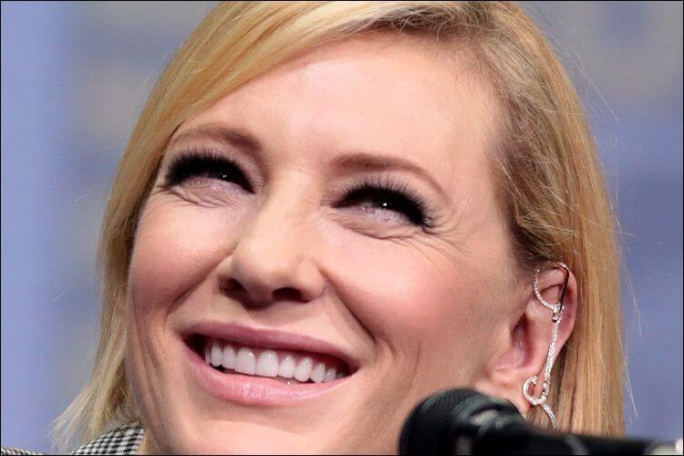 Close up of Cate Blanchett's face, with her blonde hair and a big smile