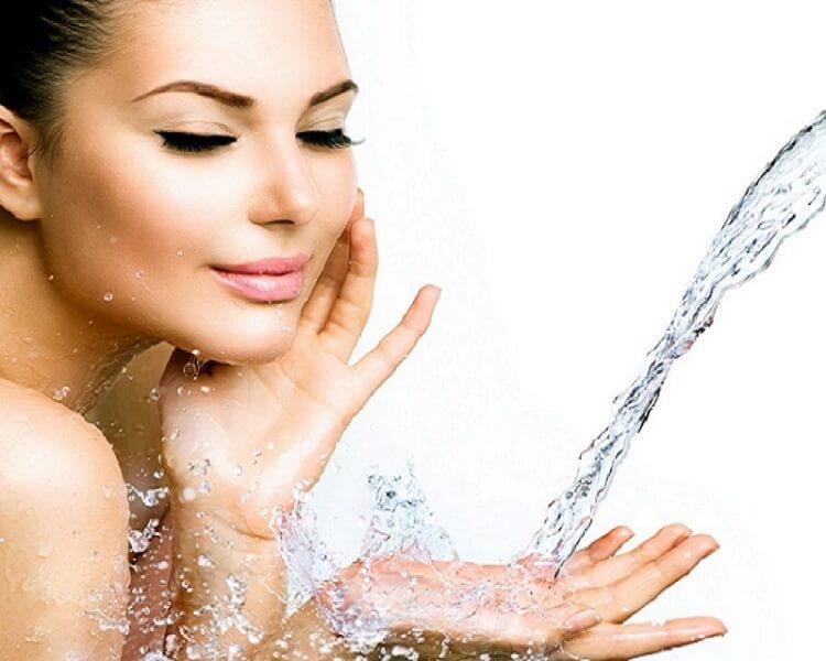 Girl splashing her face with water