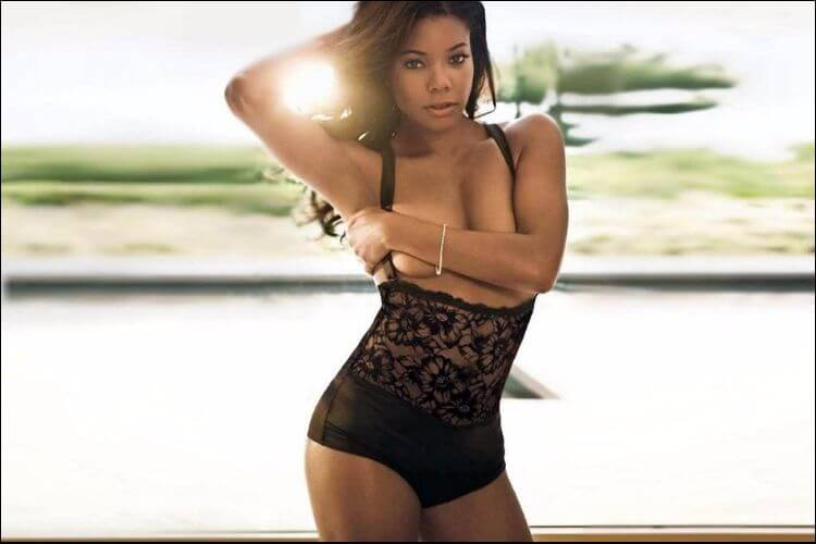 Gabrielle Union posing for the camera with the sun behind her