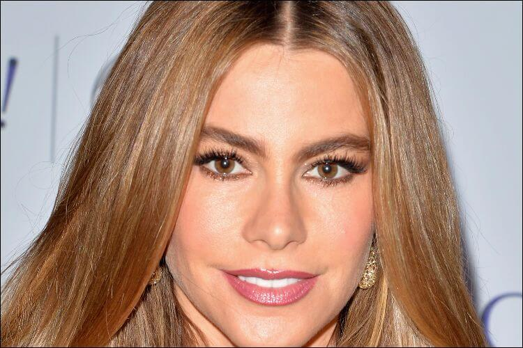 Close up of Sofia Vergara's face, smiling and looking at the camera