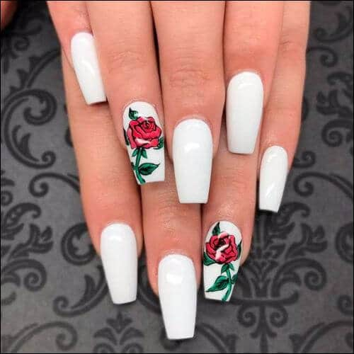 Woman Showing Her Hands With White Nails And Roses