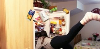 Woman searching in the fridge for something to snack on