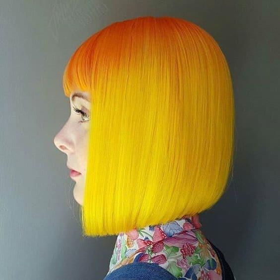 Girl wearing orange neon bob