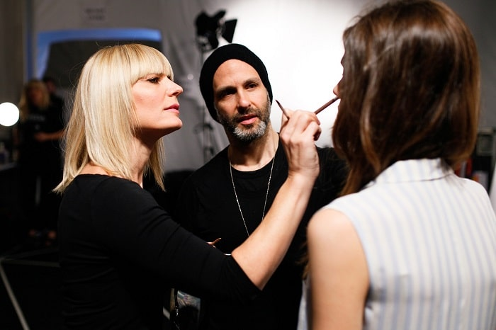 Makeup artist preparing a model