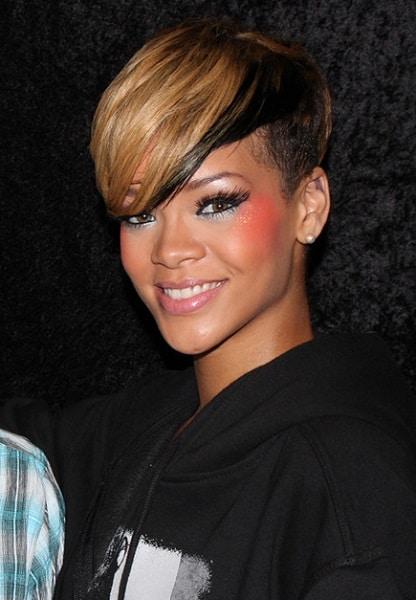 Rihanna wearing a pixie cut with long bangs