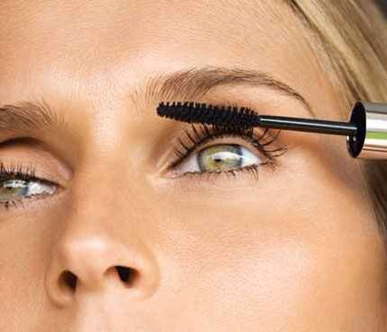 Girl applying mascara