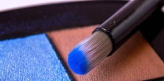 Brush in blue eye shadow