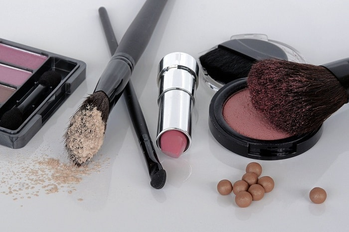 a bunch of makeup products and items