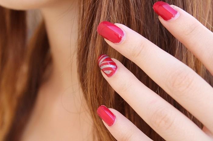 red and silver nail polish