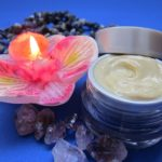 skin care cream with candle and flower