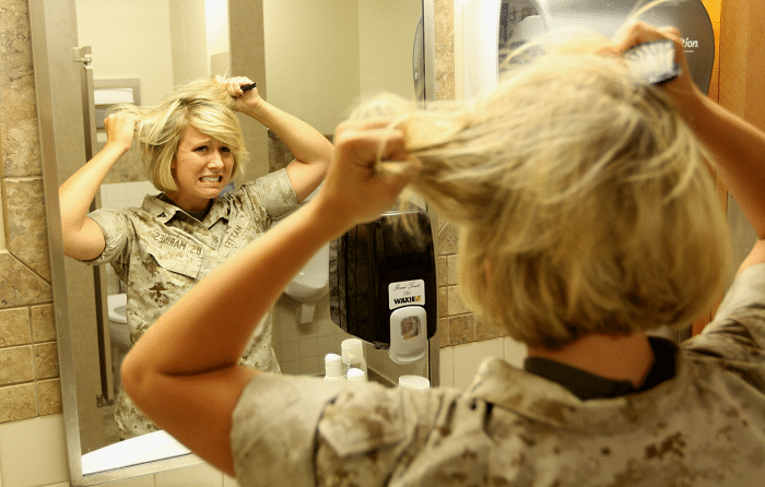 woman struggling with her short hair