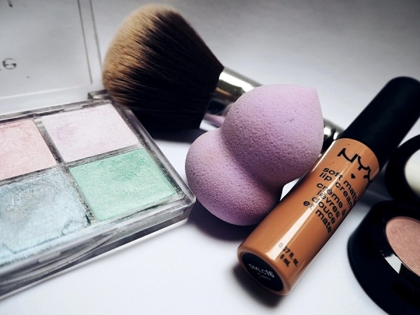 makeup accessories, palette and lipstick