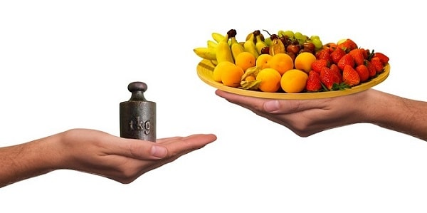 bowl of fruits and a weight