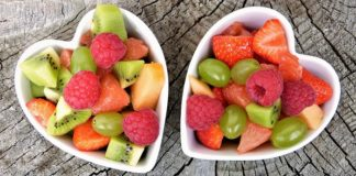 two heart-shaped bowls of fruit
