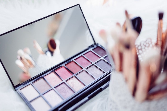makeup palette with brushes