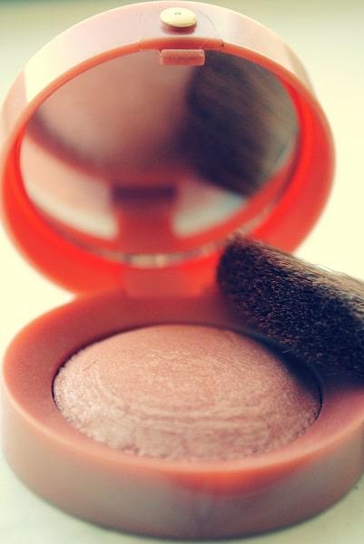 small powder bronzer and brush