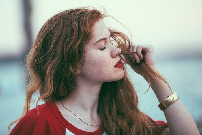 red haired-girl with red lips