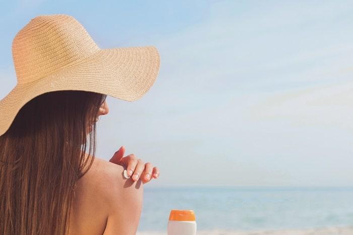 woman applying sun protection