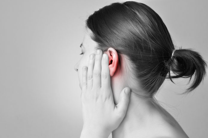 woman with an ear infection