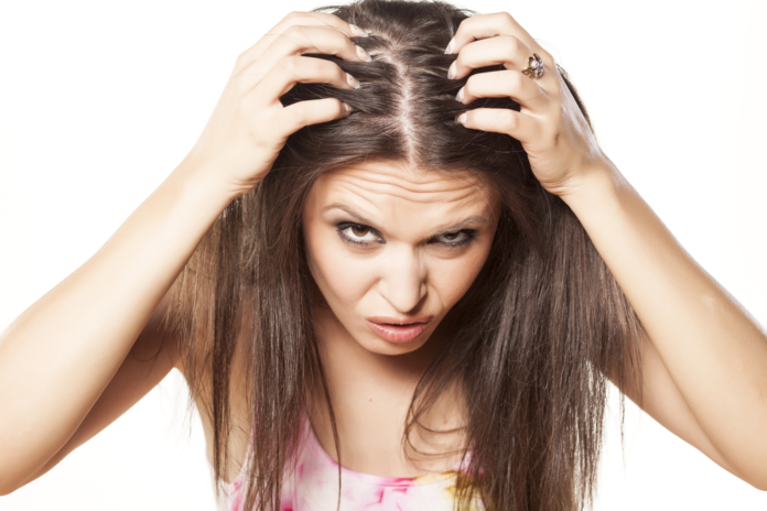 woman with itchy hair in need of ketoconazole shampoo
