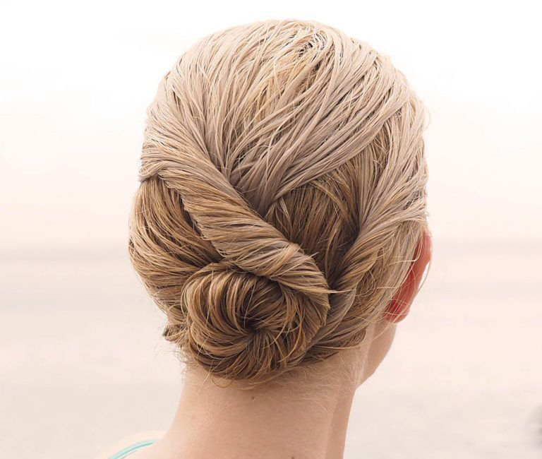 a woman with a beach bun hairstyle
