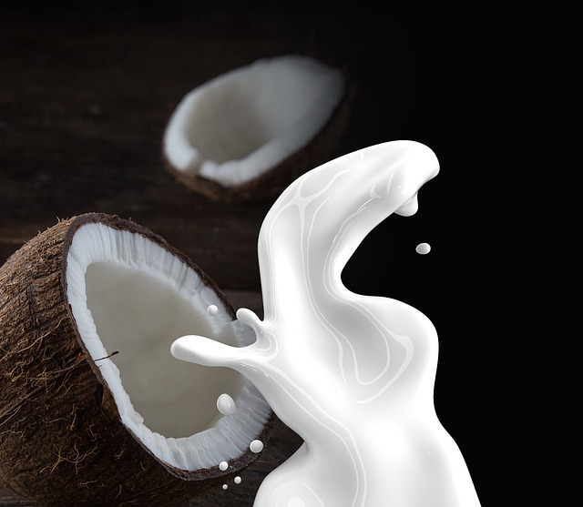 coconut cut in half and extracted coconut milk